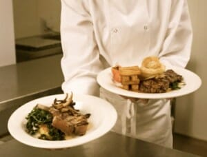 chef holding plated dinners The Importance Of Fresh Food - EAT LOVE SAVOR International Luxury Lifestyle Magazine