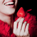 woman holding strawberry Rediscovering: Strawberries - EAT LOVE SAVOR International luxury lifestyle magazine and bookazines