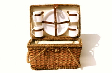 Picnic basket with dishes Gourmet Road Trips: Packing the Ultimate Picnic - EAT LOVE SAVOR International Luxury Lifestyle Magazine