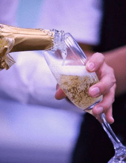 champagne being poured into a glass A Little About Champagne: Bottled Icons of Luxury - EAT LOVE SAVOR International luxury lifestyle magazine, bookazines & luxury community
