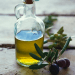 Bottle of olive oil and olives DISCOVER: OLIVES: Mythology, History and Olive Groves - EAT LOVE SAVOR International luxury lifestyle magazine and bookazines