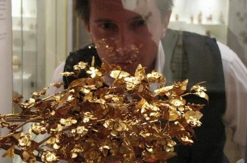 Dr. Scott looking at a gold antiquity Luxury Is... two BBC Documentaries - EAT LOVE SAVOR International Luxury Lifestyle Magazine