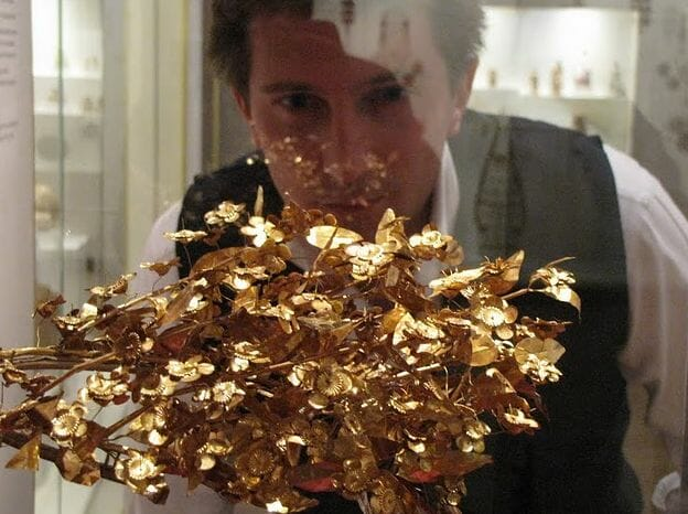Dr. Scott looking at a gold antiquity Luxury Is... two BBC Documentaries - EAT LOVE SAVOR International luxury lifestyle magazine, bookazines & luxury community