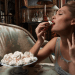 woman eating cookies Discover: The Art of Savoring - EAT LOVE SAVOR International luxury lifestyle magazine and bookazines