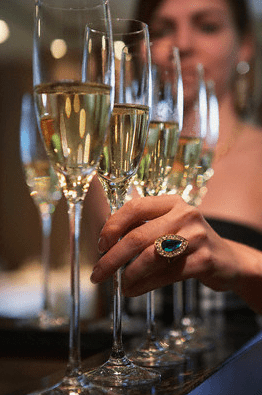 woman taking champagne glass Champagne Glossary - EAT LOVE SAVOR International luxury lifestyle magazine and bookazines