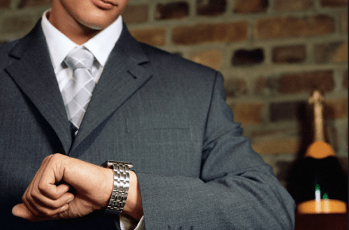 man looking at watch Tips for Women on Selecting Fine Watches for Men - EAT LOVE SAVOR International Luxury Lifestyle Magazine