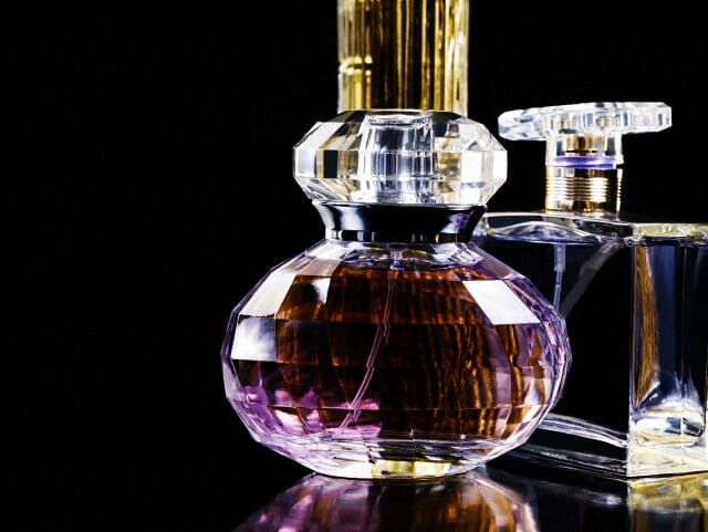 bottles of perfume The Origin and Power of Perfume - EAT LOVE SAVOR International luxury lifestyle magazine, bookazines & luxury community