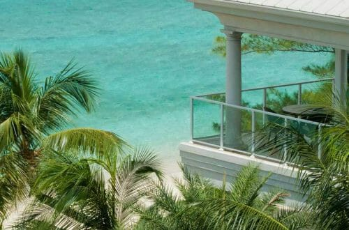caribbean club villa balcony Epic Relaxation in a Superlative Setting - Grand Cayman's Caribbean Club Hotel - EAT LOVE SAVOR International luxury lifestyle magazine, bookazines & luxury community