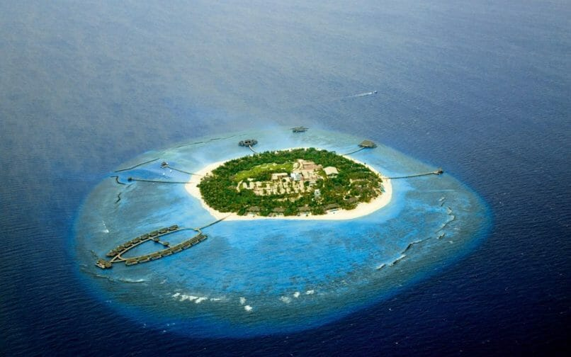 Velaa private island aerial The Ultimate Exclusive-Use Destinations for Bubble-To-Bubble Vacations - EAT LOVE SAVOR International Luxury Lifestyle Magazine