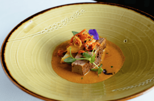 Prithvi Duck on yellow plate Discover Prithvi Restaurant's Reinvented Indian Dishes - EAT LOVE SAVOR International luxury lifestyle magazine and bookazines