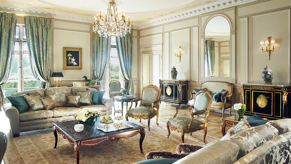"""luxury living room with glamorous sofa cozy black cabinet luxuious chandelier lamps and gorgeous blue curtain The """"A"""" List, Gentle Leisure Activities to Slow Down Time - EAT LOVE SAVOR International luxury lifestyle magazine, bookazines & luxury community"""