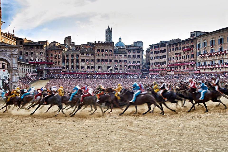 palio race italy horses running Experience One of Italy's Most Famous Traditions - EAT LOVE SAVOR International Luxury Lifestyle Magazine