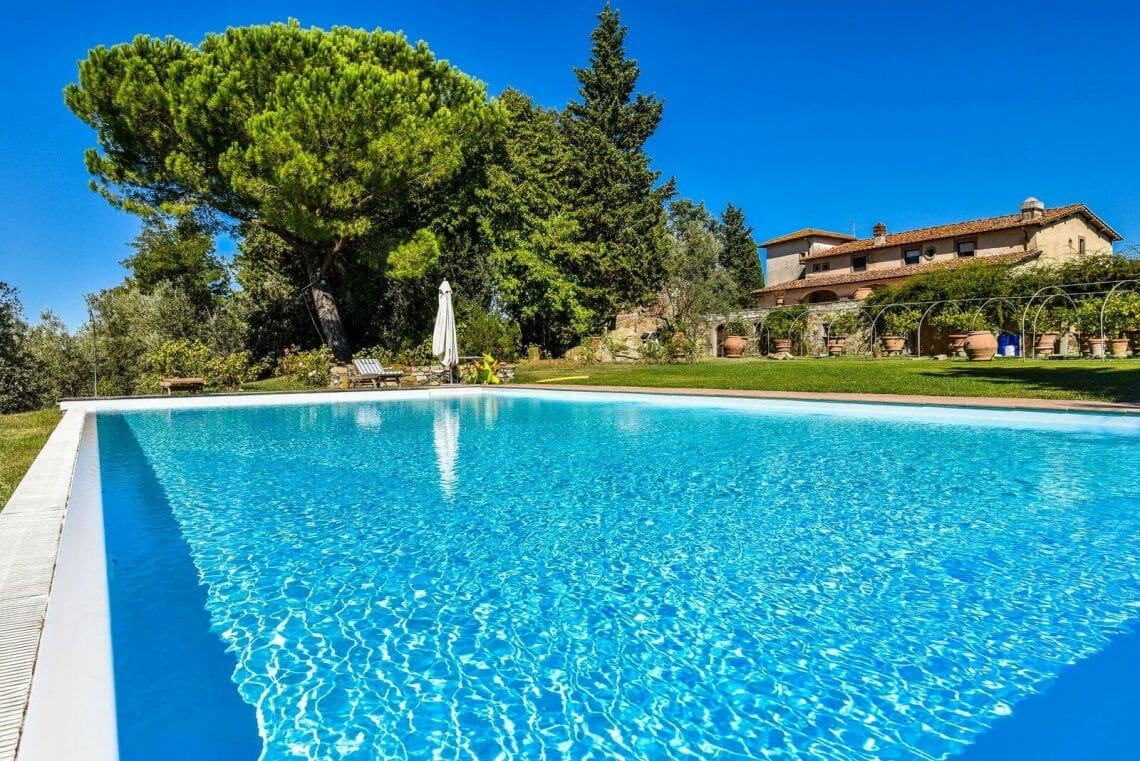 florence farmhouse exterior with pool Luxury Abode in Italy: Distinguished Style and Timeless Tradition Embodied in Tuscan Villa - EAT LOVE SAVOR International luxury lifestyle magazine and bookazines