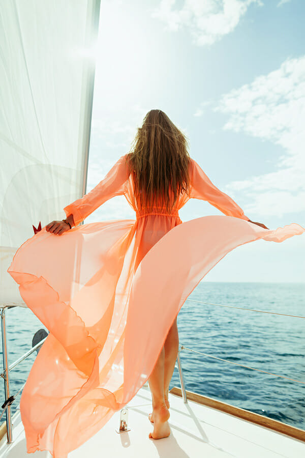 bigstock Sexy Woman In Swimwear Pareo Y 123638177 Packing for a Winter Yacht Charter - EAT LOVE SAVOR International Luxury Lifestyle Magazine