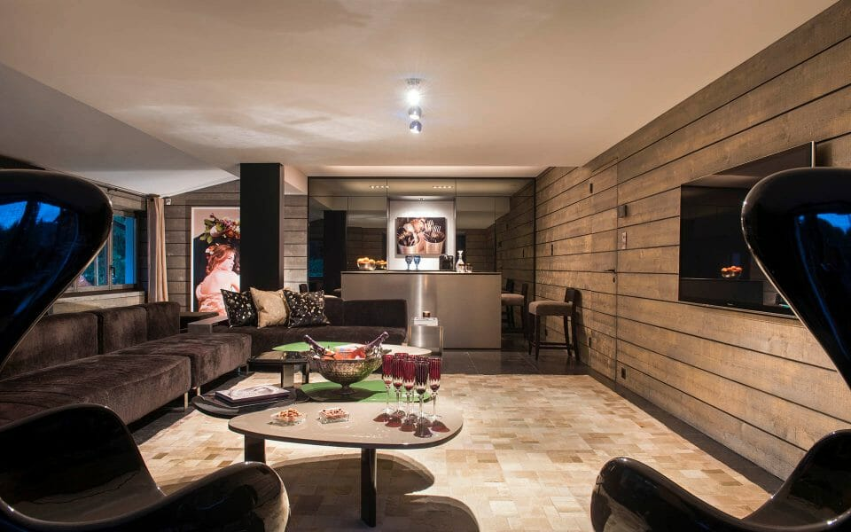 luxury chalet gstaad Aflabim TV room The 3 Best Alpine Ski Resorts for Families - EAT LOVE SAVOR International luxury lifestyle magazine and bookazines