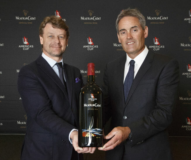 Hugues Lechanoine MD of BPhR and Sir Russell Coutts CEO of the ACEA with Mouton Cadet Americas Cup jpg Baron Philippe de Rothschild SA and the America's Cup Unveil Mouton Cadet Special Cuvée wines - EAT LOVE SAVOR International luxury lifestyle magazine and bookazines