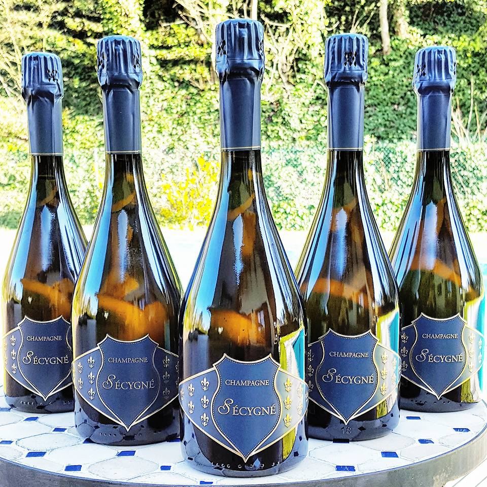 champagne secygne bottles Must-Try Champagnes, Delicious Pairings and Beautiful Flutes - EAT LOVE SAVOR International luxury lifestyle magazine, bookazines & luxury community