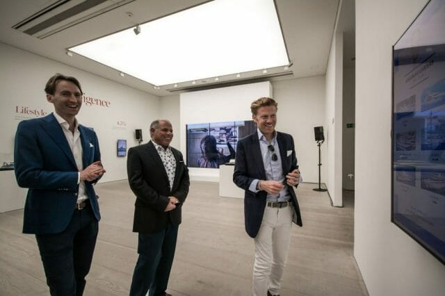 superyacht gallery men looking at art All bow for the SuperYacht Gallery at Saatchi London - EAT LOVE SAVOR International luxury lifestyle magazine, bookazines & luxury community