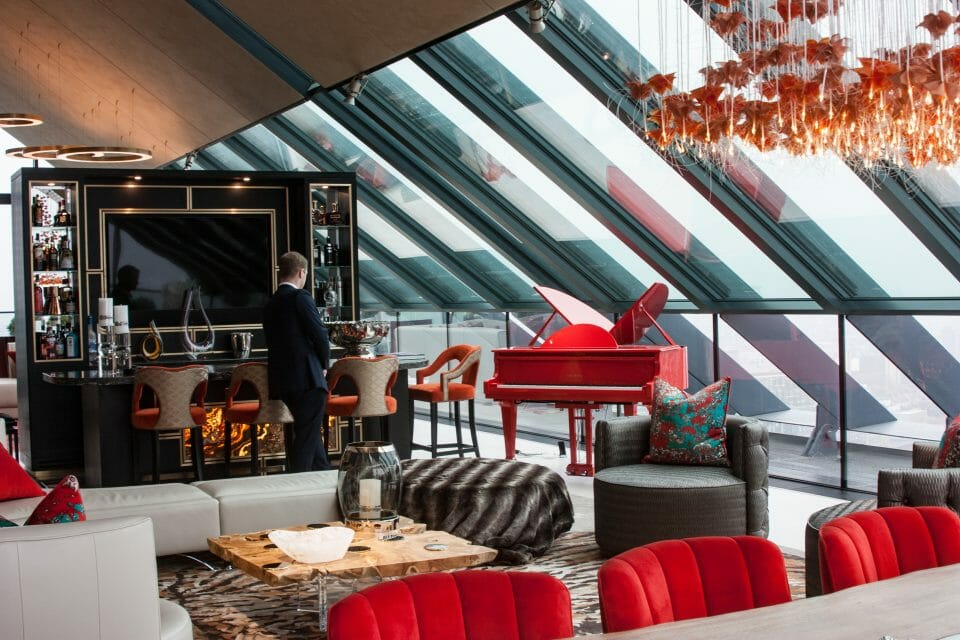 Bespoke Red Sygnet at Neo Bankside 13 Stunning Penthouse Makeover Inspired by a Ferrari Red Piano - EAT LOVE SAVOR International luxury lifestyle magazine, bookazines & luxury community