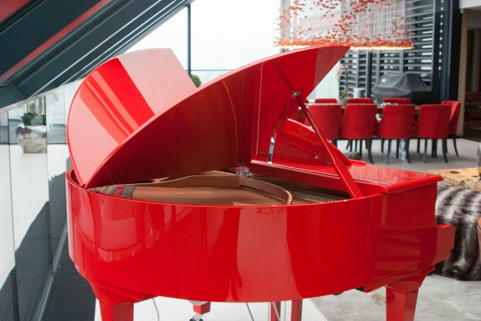 Bespoke Red Sygnet at Neo Bankside 15 Stunning Penthouse Makeover Inspired by a Ferrari Red Piano - EAT LOVE SAVOR International luxury lifestyle magazine, bookazines & luxury community
