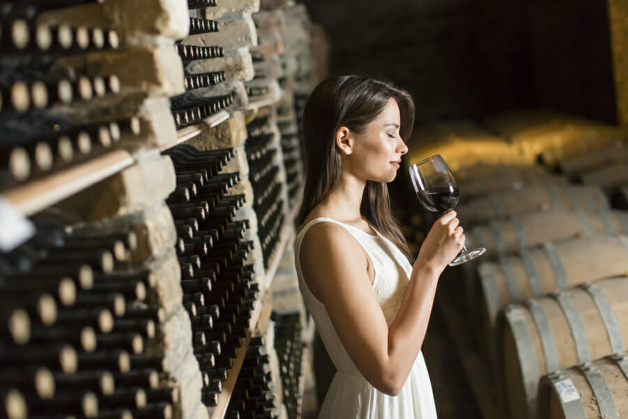bigstock Young Woman In The Wine Cellar 95812163 Cellaring Wines - EAT LOVE SAVOR International luxury lifestyle magazine and bookazines