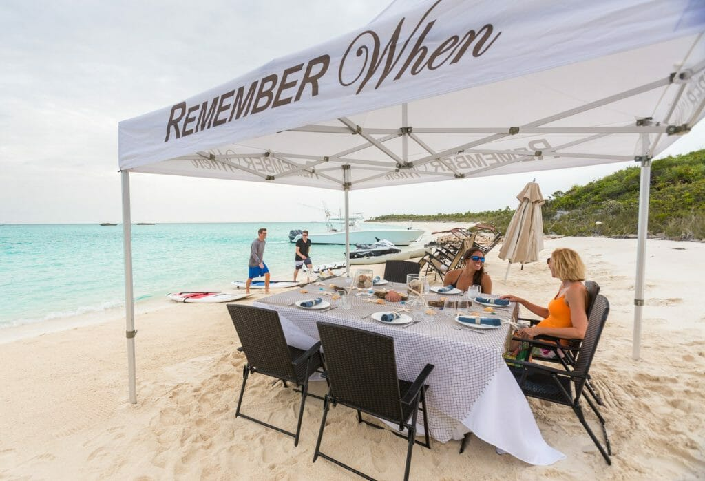 Beach set up for a relaxing meal Lush escapes to the Bahamas in style with luxury yacht Remember When - EAT LOVE SAVOR International luxury lifestyle magazine, bookazines & luxury community