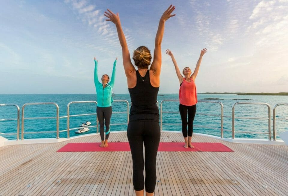 Welcoming the new day with a relaxing yoga session Lush escapes to the Bahamas in style with luxury yacht Remember When - EAT LOVE SAVOR International luxury lifestyle magazine, bookazines & luxury community