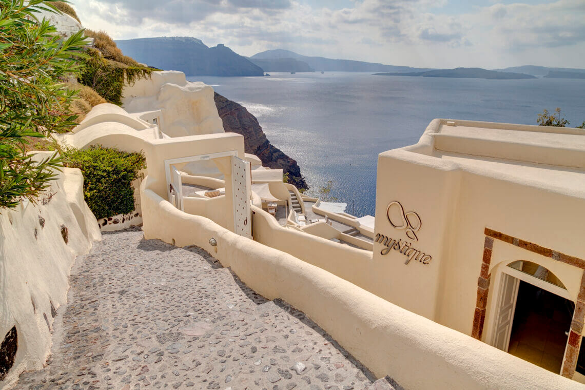 Mystique Hotel Lobby Discover the Ultimate Greek Escape for 2021: MYSTIQUE, a Luxury Collection Hotel Cut into an Extraordinary Sea Side Landscape - EAT LOVE SAVOR International Luxury Lifestyle Magazine