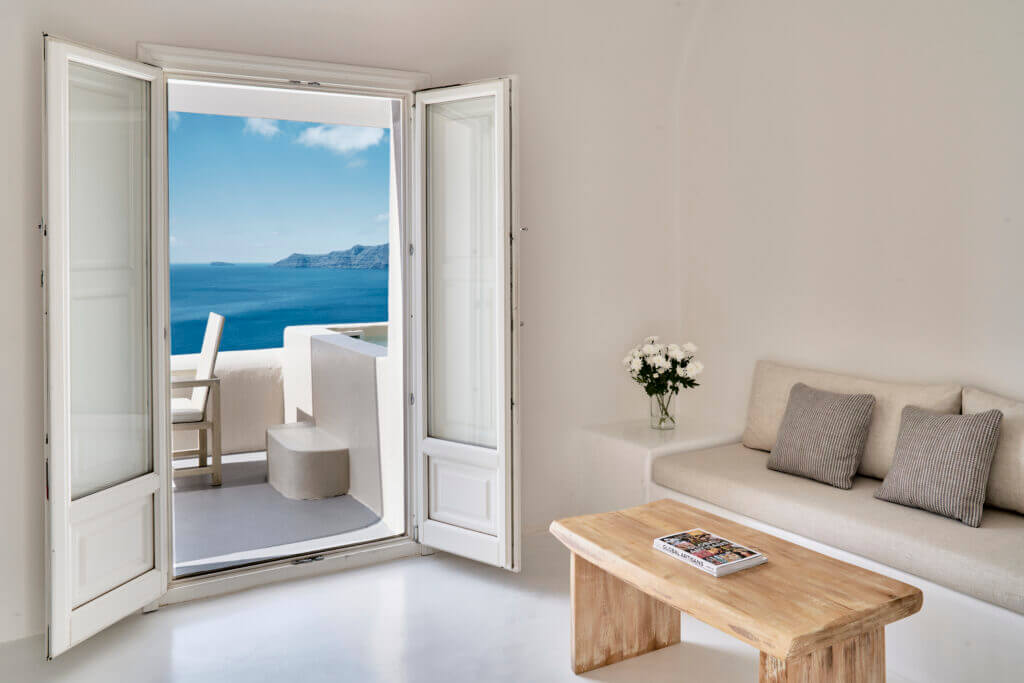 Mystique Hotel Spiritual Suite Living Area Discover the Ultimate Greek Escape for 2021: MYSTIQUE, a Luxury Collection Hotel Cut into an Extraordinary Sea Side Landscape - EAT LOVE SAVOR International Luxury Lifestyle Magazine