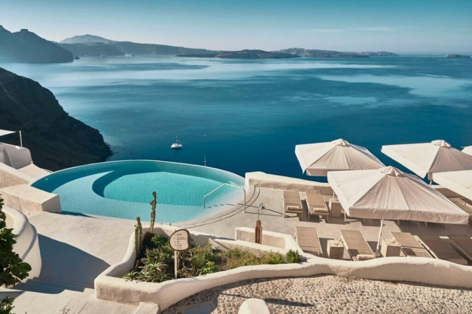 Mystique Hotel infinity pool Discover the Ultimate Greek Escape for 2021: MYSTIQUE, a Luxury Collection Hotel Cut into an Extraordinary Sea Side Landscape - EAT LOVE SAVOR International Luxury Lifestyle Magazine