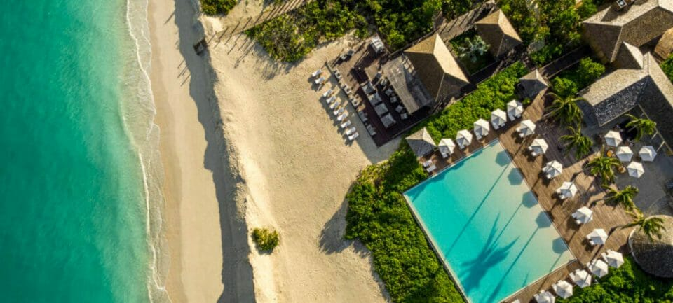 como parrot cay The Ultimate Exclusive-Use Destinations for Bubble-To-Bubble Vacations - EAT LOVE SAVOR International Luxury Lifestyle Magazine